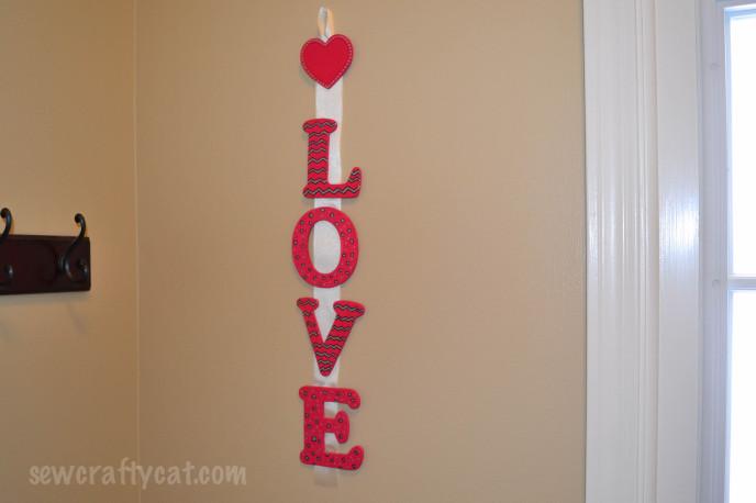 Love Sign hung on ribbon