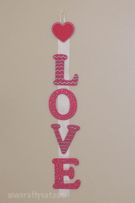love sign - painted wooden letters attached to ribbon