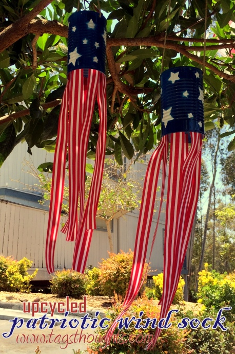 Using cans, spray paint, and ribbon, make these super cute windsocks to add a little red, white, and blue to your yard #4thofJuly #upcycled #craftproject