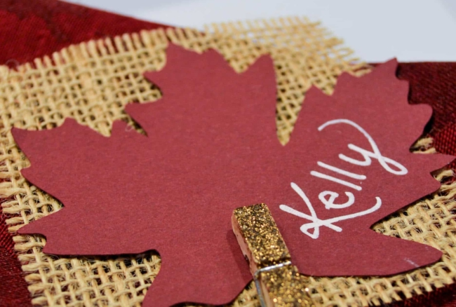 A simple place card for Thanksgiving dinner using burlap and glittered clothespins.