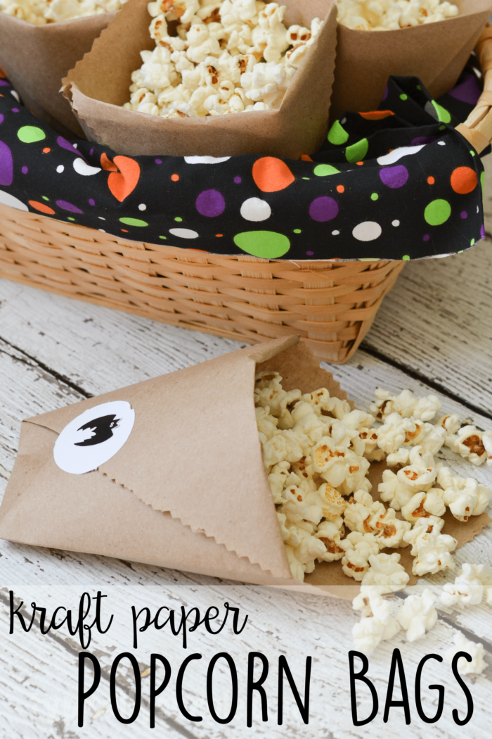 These easy DIY kraft paper bags are a fun way to serve popcorn at your Halloween parties! Just personalize the stickers to go with your party theme!