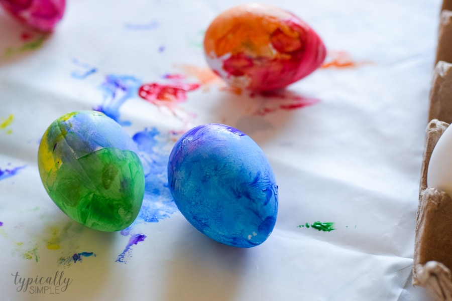 A fun alternative to using dye, grab some paint supplies to make these bright and colorful Easter eggs with the kids!