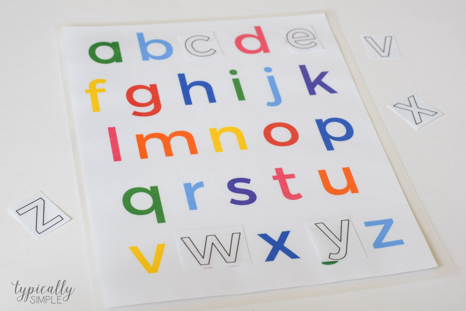 one of the activities we did was lowercase letter matching i cut apart the black line alphabet printable and those became the matching pieces