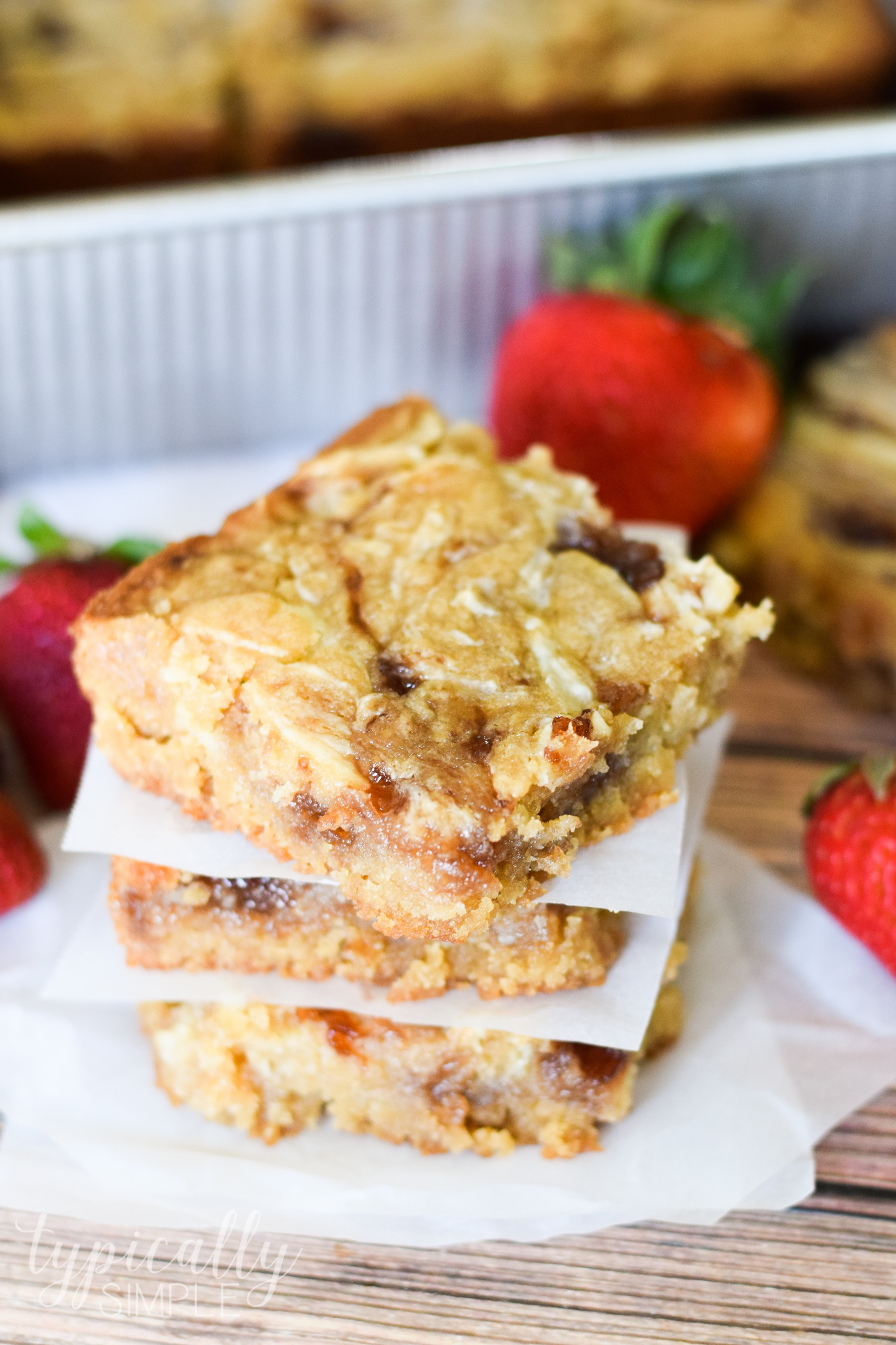 These strawberry swirl cheesecake blondie bars are a decadent treat that is quite easy to make. With some basic baking ingredients and a few minutes of prep they will quickly become your new go-to dessert to make for parties!